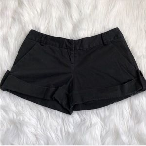Zinc black shorts with stylish buttons on side